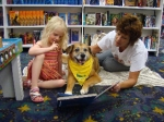Image of Laura and John McCabe & Honey, a Therapy Dog
